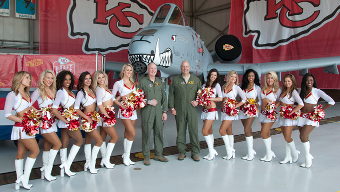 Col. Greg Eckfeld (left) and Col. Brian Borgen, vice commander and commander of the 442d Fighter Wing respectively, meet with the Kansas City Chiefs cheerleaders during the Military Appreciation Day event at Whiteman Air Force Base, Mo., April 30, 2016. Service members and their families enjoyed photo-ops and autographs with the Chiefs cheerleaders and players, among other activities. (U.S. Air Force photo by Airman 1st Class Missy Sterling)