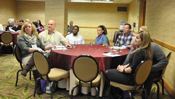 Air Force Reserve couples listen during the Yellow Ribbon Reintegration Program's initial Couples Enrichment Program class Jan. 30, 2015, in Denver.