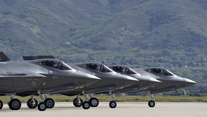 Four F-35 Lightning II aircraft prepare for takeoff at Hill Air Force Base, Utah, May 4. Hill's active duty and Reserve F-35 pilots recently began flying routine four-ship configurations, just as they would in combat. This marks a key milestone in getting the Air Force's newest fighter jet to reach Initial Operational Capability later this year, at which time it will be combat-ready. (U.S. Air Force photo/Paul Holcomb)